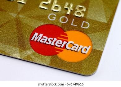 Ivano-Frankivsk, Ukraine - 30 June, 2017: Bank credit card Master Card Gold macro close-up