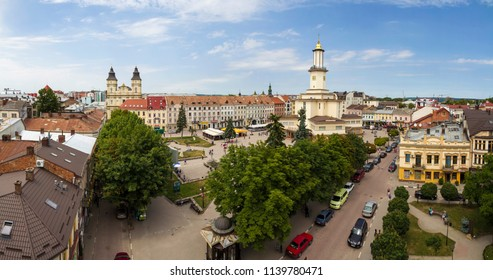 Ivano-Frankivsk, Ukraine - April 9, 2018: Aerial summer view of historic European tourist city Ivano Frankivsk center with town hall tower. Old beautiful architecture concept.
