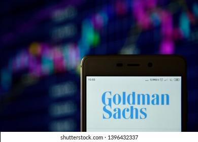 Ivano-Frankivsk, Ukraine - May 13, 2019: Goldman Sachs logo seen displayed on smart phone. Goldman Sachs logo displayed on a  smartphone over stock chart