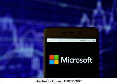 Ivano-Frankivsk, Ukraine - May 13, 2019: Microsoft Corporation logo is seen on an android mobile phone over stock chart. Microsoft Corporation logo is displayed on the screen of a mobile device.