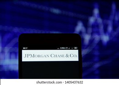 Ivano-Frankivsk, Ukraine - May 22, 2019: JPMorgan Chase logo is seen on an smartphone over stock chart. JPMorgan Chase logo is displayed on the screen of a mobile device.