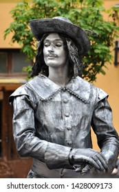 IVANO-FRANKIVSK, UKRAINE - MAY 3, 2019: First festival of living statues, musketeer in the time of Louis XIV of France . Living statue.