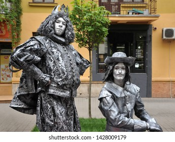 IVANO-FRANKIVSK, UKRAINE - MAY 3, 2019: First festival of living statues, Medieval French king and musketeer. Living statues.