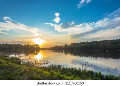 Ivanovo city, Ivanovo region, Russia-16.05.2018: Beautiful orange sunset on the Uvod river 16.05.2018 in Ivanovo city, Ivanovo region, Russia.