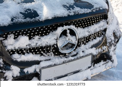 Ivanovo, Russia – January 22, 2018: Mercedes-Benz car stands parked on the roadside. Mercedes logo on the hood in the snow. Front view.