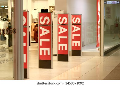 Ivanovo, Russia - July 2019: Anti-theft sensor gates at the entrance to the clothing store. Shopping sale background. Store discount sign.
