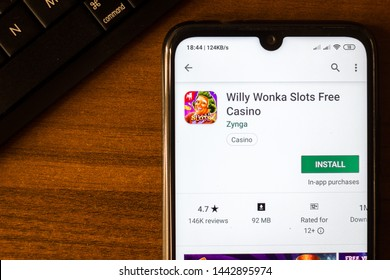 Ivanovsk, Russia - June 26, 2019: Willy Wonka Slots Free Casino app on the display of smartphone or tablet.