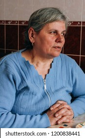 Ivanychi, Volyn / Ukraine - March 20 2009: Senior woman at home