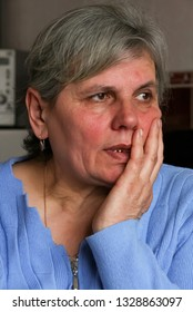 Ivanychi, Volyn / Ukraine - March 20 2009: Senior woman posing at home