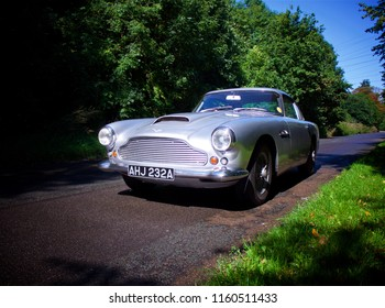 Iver, Buckinghamshire/ UK - 31 08 2017: Shot of Aston Martin DB4 parked on a road - left side