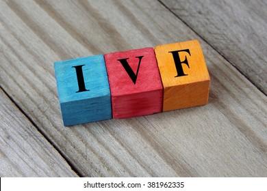 IVF (In Vitro Fertilization) acronym on colorful wooden cubes