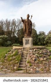 Ivinets, Minsk Region / Republic of Belarus 09.27.2020: Catholic Church of St. Michael the Archangel. Statue of Jan Paul II