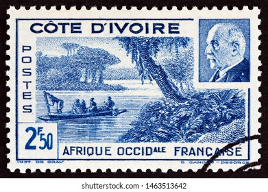 IVORY COAST - CIRCA 1941: A stamp printed in Ivory Coast shows Ebrie Lagoon and Marshal Petain, circa 1941.