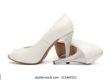 Ivory female wedding footwear isolated over white background
