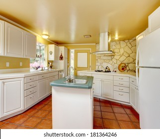 Ivory wall kitchen room with white storage combination and stone trim wall