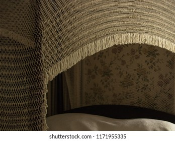 Ivory, white crocheted 1800s antique canopy over vintage bed, romantic decor illustrates elegance