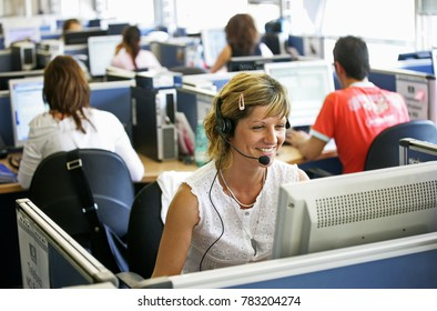 Ivrea, Italy - April 20, 2013: Young woman working in call center