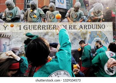 Ivrea, Italy. March 03, 2019. Carnival parade with orange battle