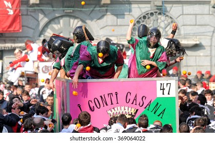 IVREA, ITALY-FEBRUARY 15, 2010: traditional Orange battle fighters during the historical carnival, in Ivrea.
