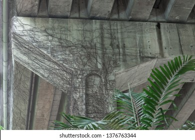 ivy covered column of overpass