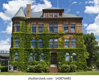 Ivy Covered Hopkins Hall at Williams College in Williamstown, Massahusetts on a beautiful summer's day.