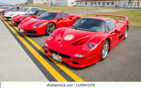 IWAKUNI, JAPAN - MAY 5, 2018: A long line of Ferrari sports cars on a runway at a U.S. base on Japan-U.S. Friendship Day, a free, non-ticketed event. From the right: A Ferrari F50 and a Ferrari V8.