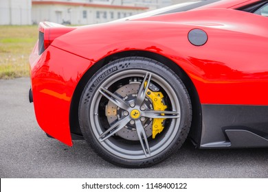 IWAKUNI, JAPAN - MAY 5, 2018: A close up, side view of the back and tire of a bright red Ferrari luxury sports car at a U.S. base on Japan-U.S. Friendship Day, a free, non-ticketed event.