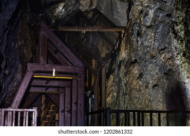 Iwami Ginzan (Silver Mine), Ohkubo Mineshaft; steel frames support the tunnel walls and a staircase accessing a large room inside the mine