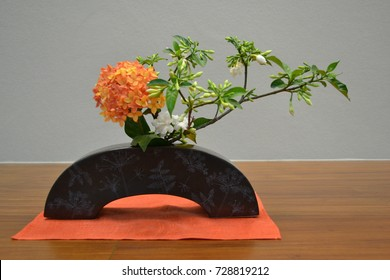 Ixora and gardenia flowers: Ikebana, the Japanese art of flower arrangement is applied for using some flowers in Thailand.
