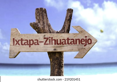 Ixtapa-Zihuatanejo wooden sign with a beach on background