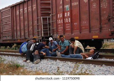 Ixtepec, Oaxaca/Mexico-2012. Central American migrants and asylum-seekers prepare to board the freight train they call La Bestia.