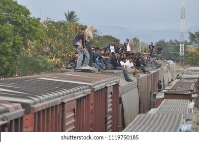 Ixtepec, Oaxaca/Mexico-2012. Central American migrants and asylum-seekers riding the freight train they call La Bestia.