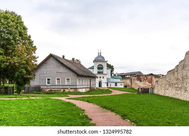The Izborsk fortress. The ruins of the oldest stone fortress in Russia. The walls of the fortress and orthodox church of St. Nicholas in the Izborsk fortress. Izborsk, Pskov region, Russia