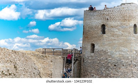 IZBORSK, RUSSIA - MAY 3, 2014: Old medieval castle of Izborsk in Russia. Tower and castle wall with blue cluody sky in background.