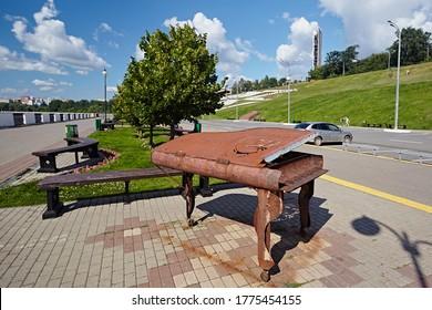 Izhevsk region, Russia - August 2017:  Metal sculpture piano on a city street