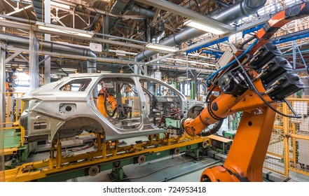 IZHEVSK, RUSSIA - AUGUST 15: Robots welding in a car factory. Welding new LADA Vesta SW Cross car body in Automobile Factory AVTOVAZ on August 15, 2017 in Izhevsk
