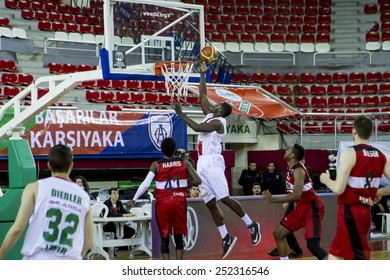 IZMIR - JANUARY 31: Pinar Karsiyaka's JUAN DIEGO TELLO PALACIOS layups to the basket in Turkish Basketball League game between Pinar Karsiyaka 82-76 Nsk Eskisehir Basket on January 31, 2015 in Izmir