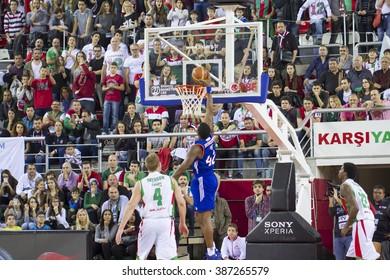 IZMIR MARCH 06: Anadolu Efes' BRYANT DUNSTON slam dunks to the basket in Turkish Basketball League game between Pinar Karsiyaka 77-89 Anadolu Efes on March 06, 2016 in Izmir, Turkey