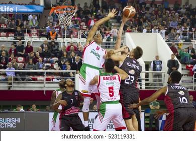 IZMIR - NOV 19: Pinar Karsiyaka's JOSH OWENS  jump for grab rebound in Turkish Basketball League game between Pinar Karsiyaka 85 - 75 Muratbey Usak on November 19, 2016 in Izmir