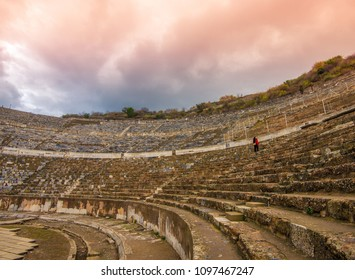 Selçuk, Izmir Providence, Turkey - Circa December 2017 - A shot of Ephesus Theatre ruins of a Greek city which is currently under restoration with an unidentified tourist in the background