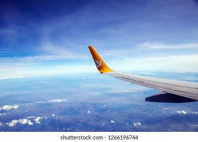 Izmir / Turkey - 12/24/2018: Wing of Pegasus Airlines plane flying over Izmir