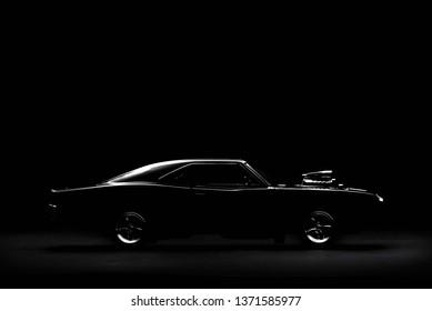 Izmir, Turkey - April 17, 2019. 1968 Dodge Charger model car product shot. Right side view on a black background. Fast and Furious movie model.