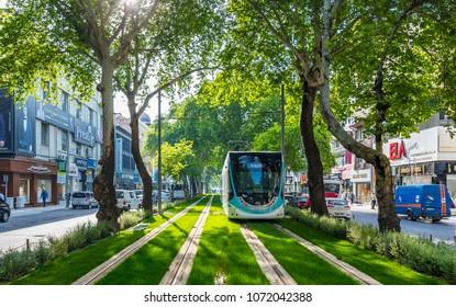 Izmir, Turkey - April 18, 2018 : Tramway is traveling on Gazi Street of Izmir City.