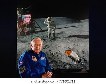 IZMIR, TURKEY - April 29, 2013: Astronaut Charlie Duke appears with a NASA image of his Apollo 16 moon landing during a special media day at Space Camp Turkey.