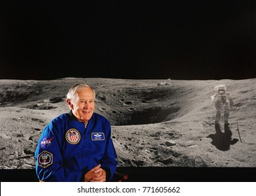 IZMIR, TURKEY - April 29, 2013: Astronaut Charlie Duke appears with a NASA image of his Apollo 16 moon walk during a special media day at Space Camp Turkey.
