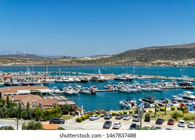 IZMIR, TURKEY, AUGUST 1, 2019: Wide angle view from Port Alacati Marina, famous yacht marina with many cafe and restaurants,major tourist attraction in Alacati region.