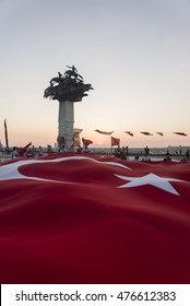 Izmir, Turkey - August 30, 2016: Alsancak gundogdu square. 30 August is victory bairam in Turkey and people are celebrating. There is a Huge Turkish flag.
