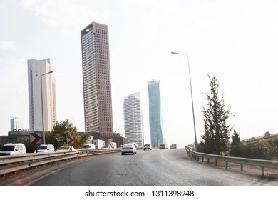 Izmir, Turkey - August  8 2018: Ege perla skyscrapper and Mistral skysrapper view from Ankara Road with traffic in Izmir Turkey.
