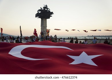 Izmir, Turkey - August30, 2016: Alsancak gundogdu square. 30 August is victory bairam in Turkey and people are celebrating. There is a Huge Turkish flag.