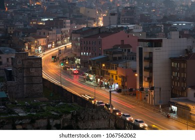 Izmir, Turkey - Circa December 2017 - An aerial shot during night time of part of Izmir, Turkey cityscape with moving vehicles on the street